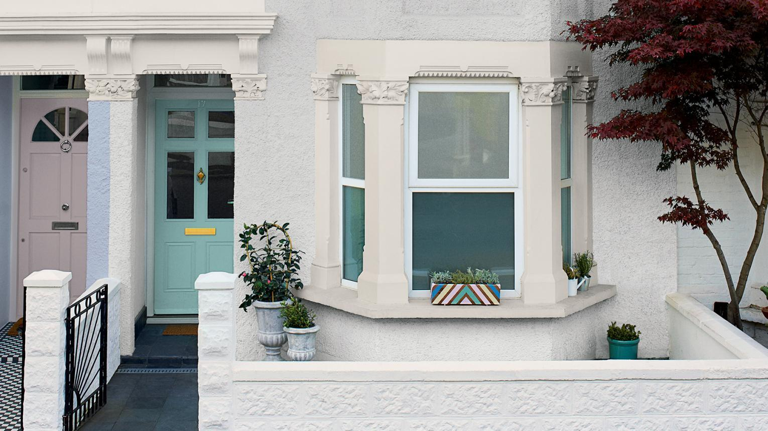 teal front door white house
